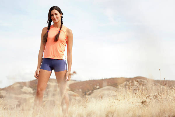 Wall Art - Photograph - An Athletic Female In Braids Standing by Jordan Siemens