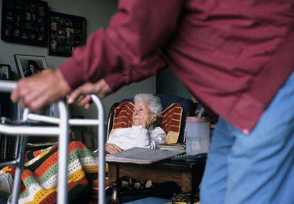 Social Living Wall Art - Photograph - An Elderly Couple At Home by Ron Koeberer