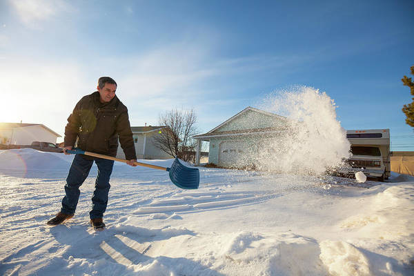 Wall Art - Photograph - An Elderly Man Shovels Snow In Northern by Christopher Kimmel