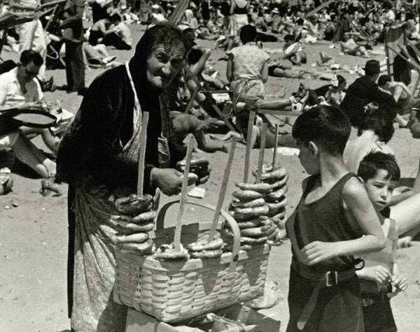 Summer Photograph - An Elderly Woman Selling Food On The Beach by Lusha Nelson