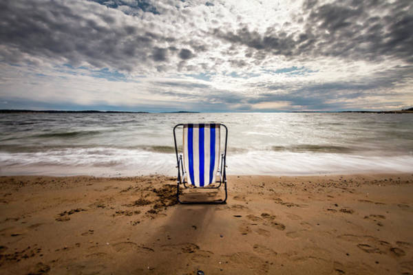 Deck Chair Photograph - An Empty Deck Chair On A Beach by Runar Vestli