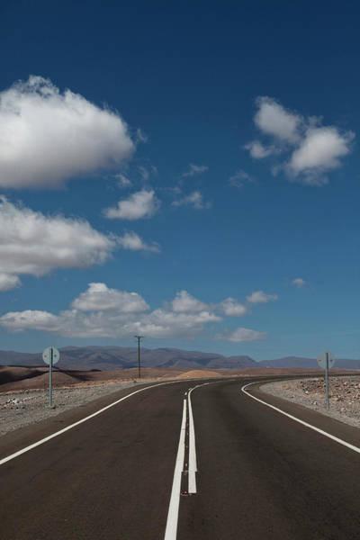 Salar De Atacama Photograph - An Empty Road Beneath A Blue Sky by Michael Hanson