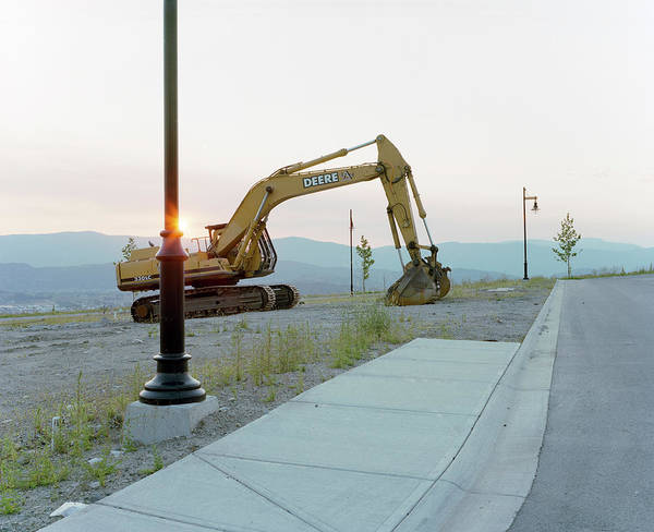 Kelowna Wall Art - Photograph - An Excavator Sits Idle On An by Andrew Querner