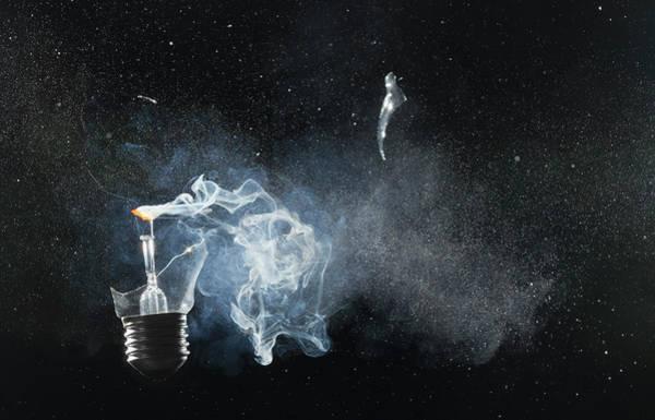Photograph - An Exploded Light Bulb by Dual Dual