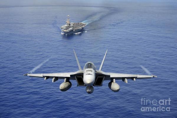 A-18 Hornet Wall Art - Photograph - An Fa-18e Super Hornet Flying Above Uss by Stocktrek Images