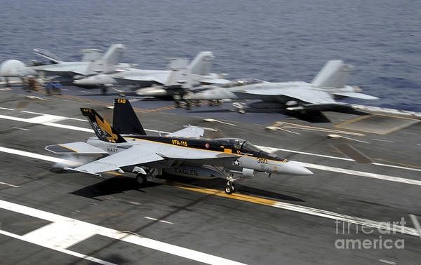 Uss George Washington Wall Art - Photograph - An Fa-18e Super Hornet Makes An by Stocktrek Images
