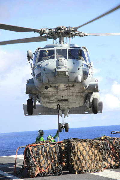 Uss George Washington Wall Art - Photograph - An Hh-60h Sea Hawk Helicopter Picks by Stocktrek Images