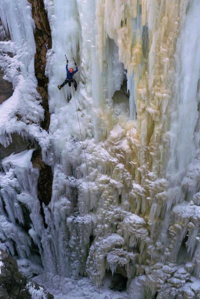 Box Canyon Wall Art - Photograph - An Ice Climber Ascends A Frozen by Randy Barnes