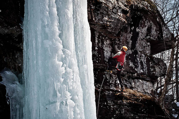 New Years Day Photograph - An Ice Climber Climbing A Difficult by Christopher Beauchamp