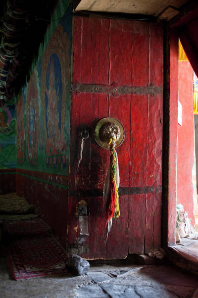 Himalaya Wall Art - Photograph - An Interior Of A Prayer Room With Door by Kevin Kerr