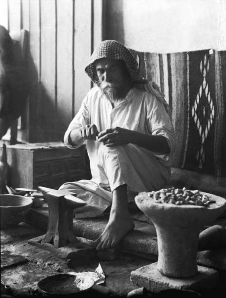 Wall Art - Photograph - An Iraqi Silversmith At Work by Underwood Archives