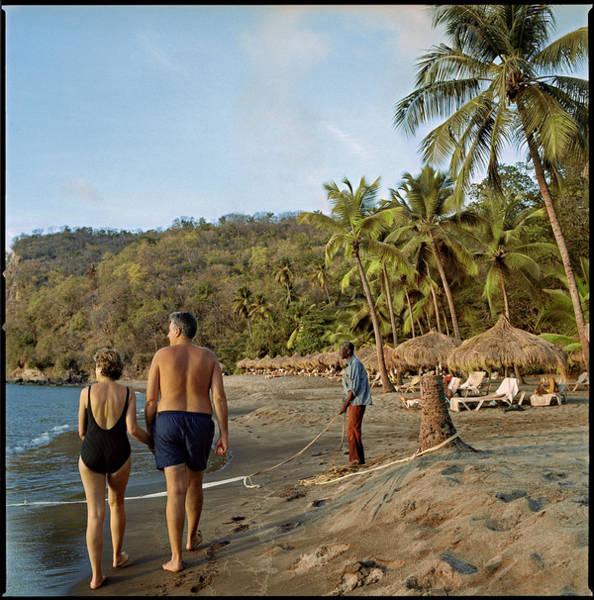 St. Lucia Photograph - An Middle-aged Tourist Couple Strolls by Katja Heinemann