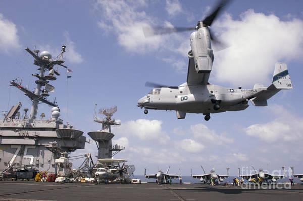 Mv-22 Photograph - An Mv-22 Osprey Lands Aboard Uss Harry by Stocktrek Images