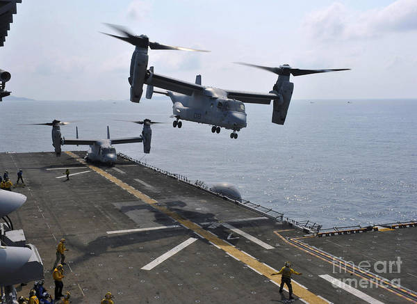Mv-22 Photograph - An Mv-22 Osprey Takes Off From Uss by Stocktrek Images