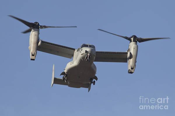 Mv-22 Photograph - An Mv-22b Osprey Prepares For Landing by Timm Ziegenthaler