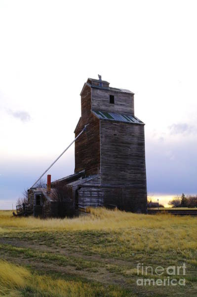 Grain Elevator Photograph - An Old Grain Elevator Off Highway Two In Montana by Jeff Swan