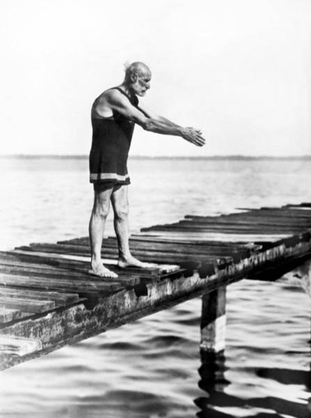 Caucasian Wall Art - Photograph - An Old Man Prepares To Dive by Underwood Archives