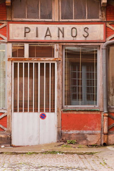 Piano Photograph - An Old Piano Store In The City Of by Julian Elliott / Robertharding