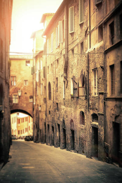 Vertical Perspective Photograph - Ancient Italian Street In Siena, Tilt by Giorgiomagini
