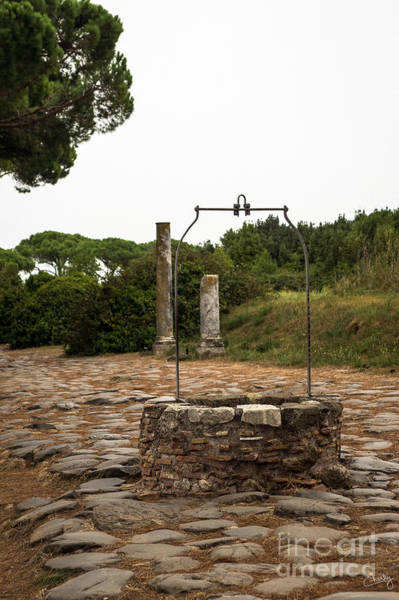 Photograph - Ancient Well Of Ostia Antica by Prints of Italy