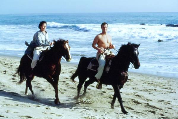 Wall Art - Photograph - Andie Macdowell And Paul Qualley Riding Horses by Arthur Elgort