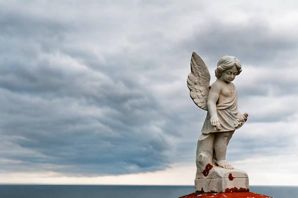 Photograph - Angel Under Storm Clouds  by U Schade