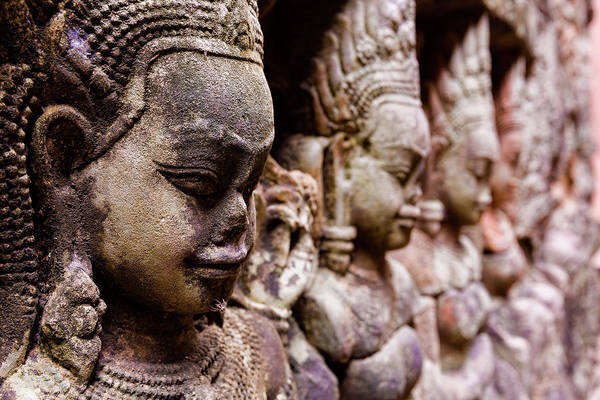 Cambodian Photograph - Angkor Wat Temple Wall Faces Detail by Daniel Osterkamp