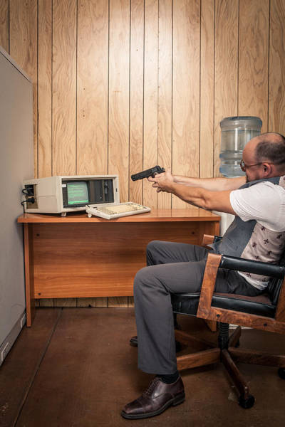 Angry Office Working Aiming Gun At Old Computer Art Print by Sjharmon