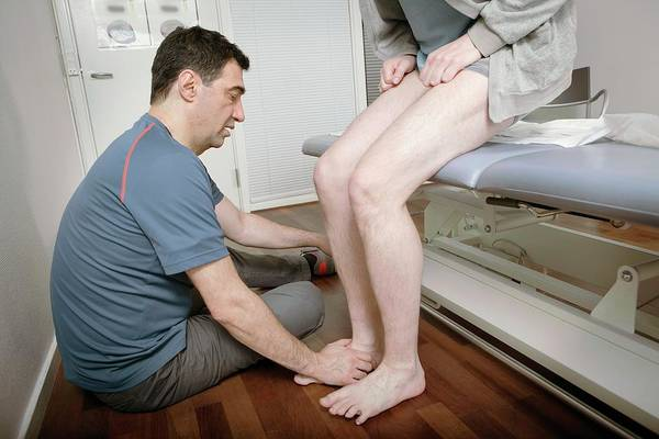 Therapist Photograph - Ankle Physiotherapy by Thomas Fredberg
