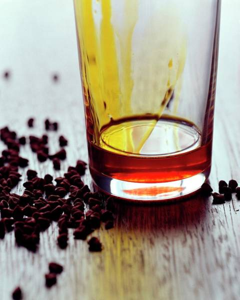 2007 Photograph - Annatto Seeds With A Glass by Romulo Yanes