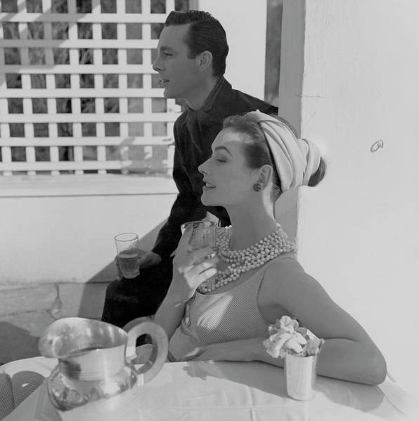 Glamour Photograph - Anne Gunning Parker Sitting With A Man by Horst P. Horst