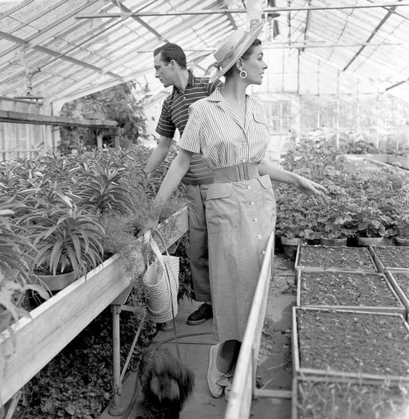 Agriculture Photograph - Anne Gunning Parker With A Man In A Greenhouse by Horst P. Horst