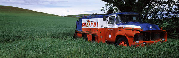 Peacefulness Photograph - Antique Gas Truck On A Landscape by Panoramic Images