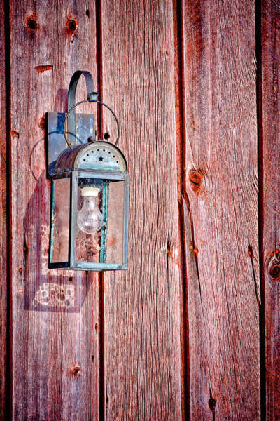 Photograph - Antique Lantern On Weathered Red Barn by Jeff Sinon