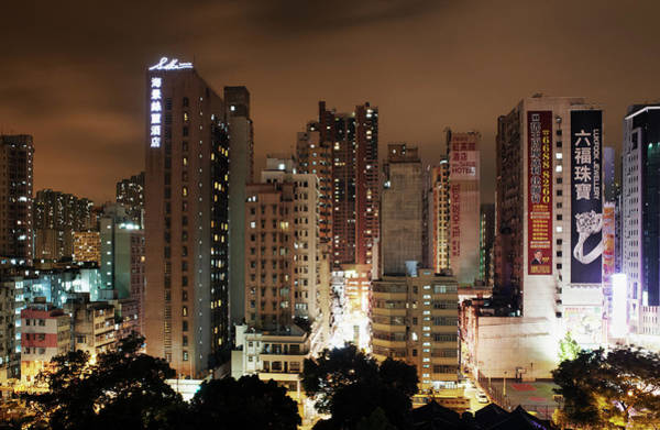 Kowloon Photograph - Apartments And Skyscrapers At Night by Gary Yeowell