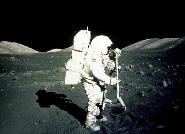 Wall Art - Photograph - Apollo 17 Astronaut Collecting Lunar Rock Samples by Nasa/science Photo Library