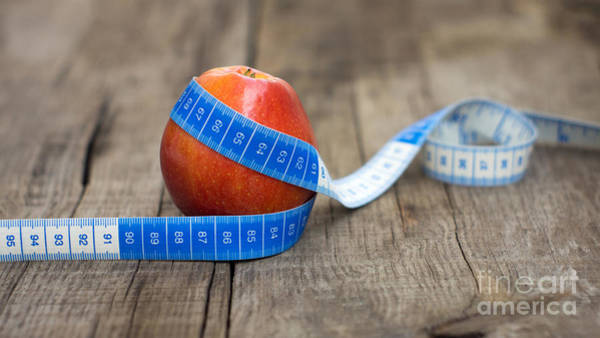Wall Art - Photograph - Apple And Measuring Tape by Aged Pixel