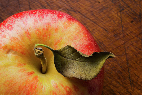 Wood Photograph - Apple On Wooden Table by Tetra Images