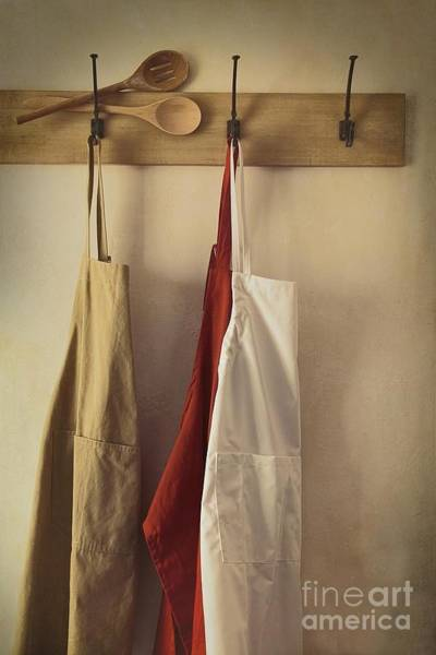 Photograph - Aprons Hanging On Hooks With Vintage Feel by Sandra Cunningham