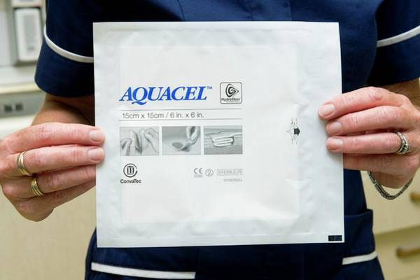 Dressing Photograph - Aquacel Wound Dressing by Dr P. Marazzi/science Photo Library