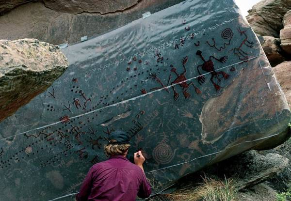 Petroglyph Photograph - Archaeologists Tracing Petroglyphs Onto Plastic by Keith Kent/science Photo Library
