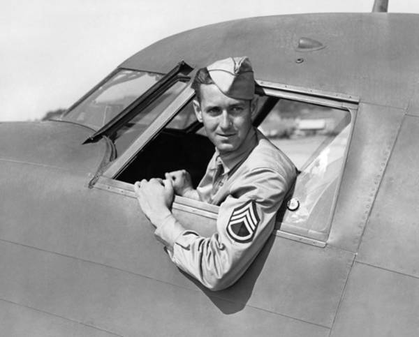 Pilot Photograph - Army Pilot Looking Out Window by Underwood Archives