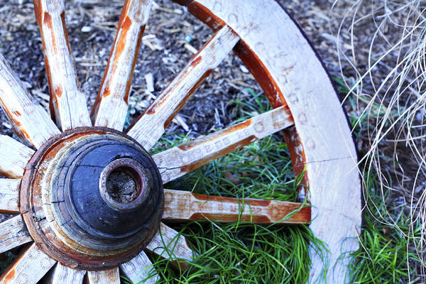 Photograph - Artful Wagon Wheel by Marilyn Hunt