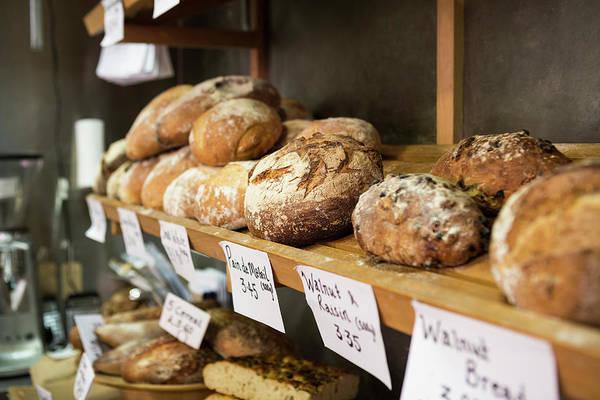 Delicatessen Photograph - Artisan Bread On Shelves In Bakery by Betsie Van Der Meer