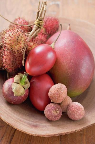 Wall Art - Photograph - Assorted Exotic Fruits In A Dish by Foodcollection