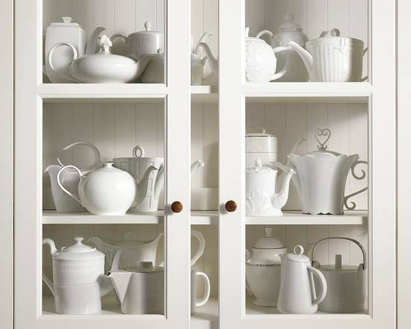 Coffee Photograph - Assorted Tea And Coffee Pots In A Glass Cupboard by Sivan Lewin