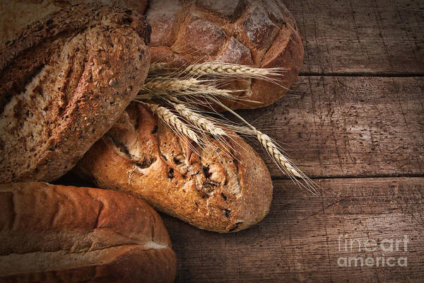 Photograph - Assortment Of Loaves Of Bread On Wood by Sandra Cunningham