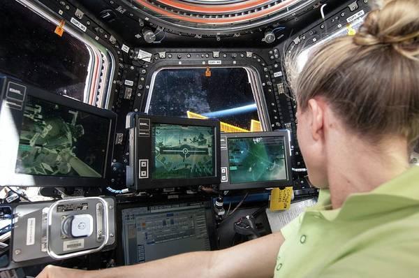 Astronaut Wall Art - Photograph - Astronaut In Iss Robotics Workstation by Nasa
