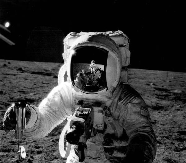 Astronaut Wall Art - Photograph - Astronaut On The Moon by Retro Images Archive