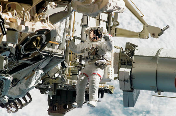 Iss Photograph - Astronaut Performing A Spacewalk by Nasa/science Photo Library